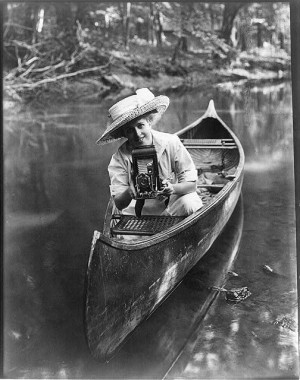 woman-canoe-pointing-camera-1909