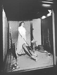 Wax Figure Vacuuming in Store Window 1914